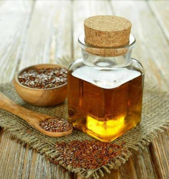 Как пьют льняное масло для понижения холестерина, какая должна быть дозировка, вред и польза продукта